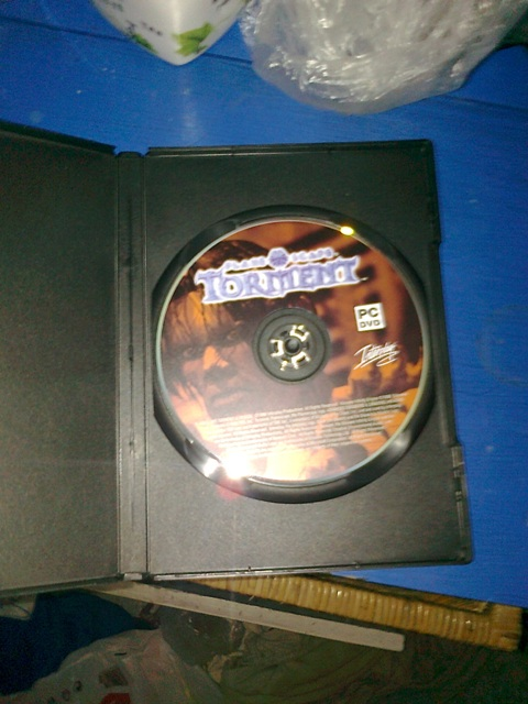 Planescape: Torment DVD! Hurá! Fa11bf706edcc65ea6744b793ba43b977a053394